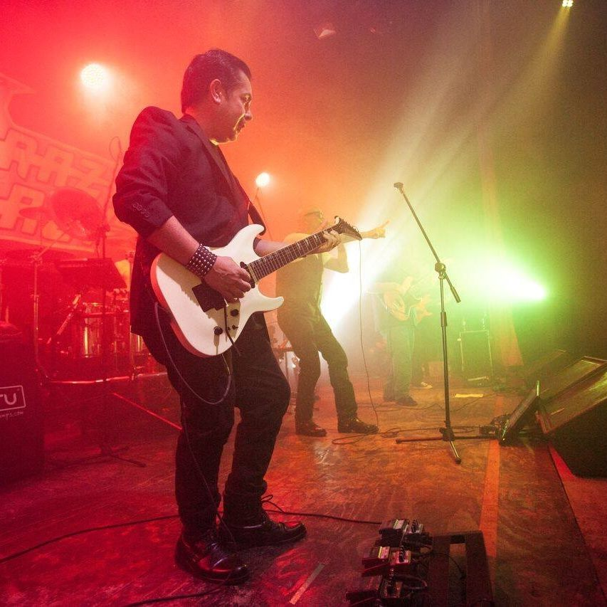 Antonio Benitez onstage with guitar.jpg