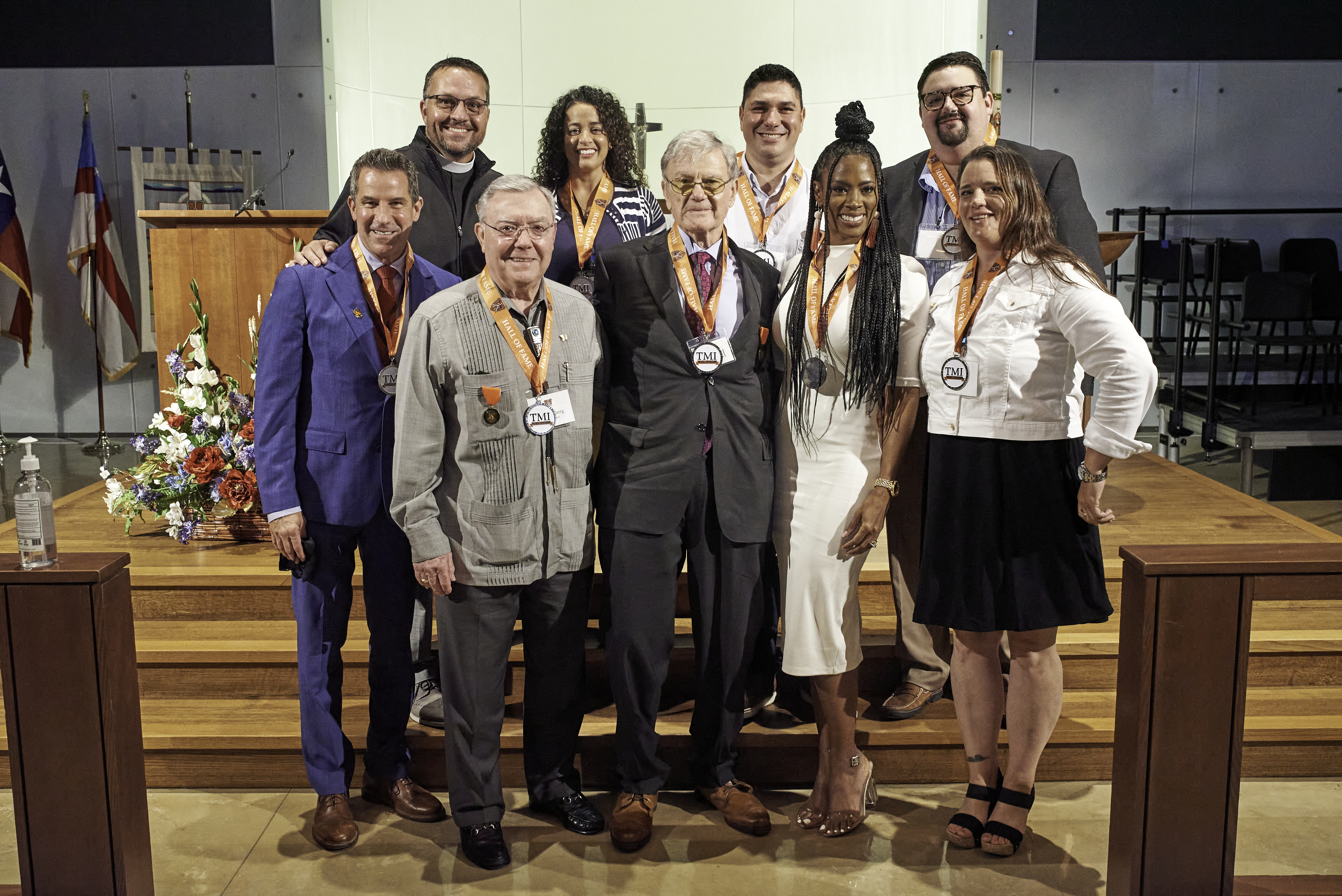 Father Scott with alumni Hall of Fame inductees.jpg