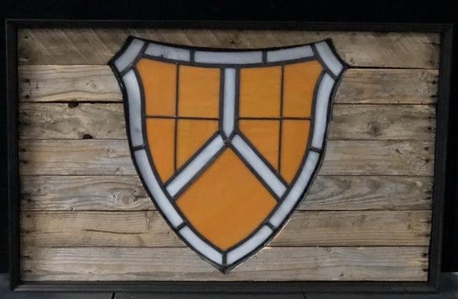 TMI shield stained glass.jpg