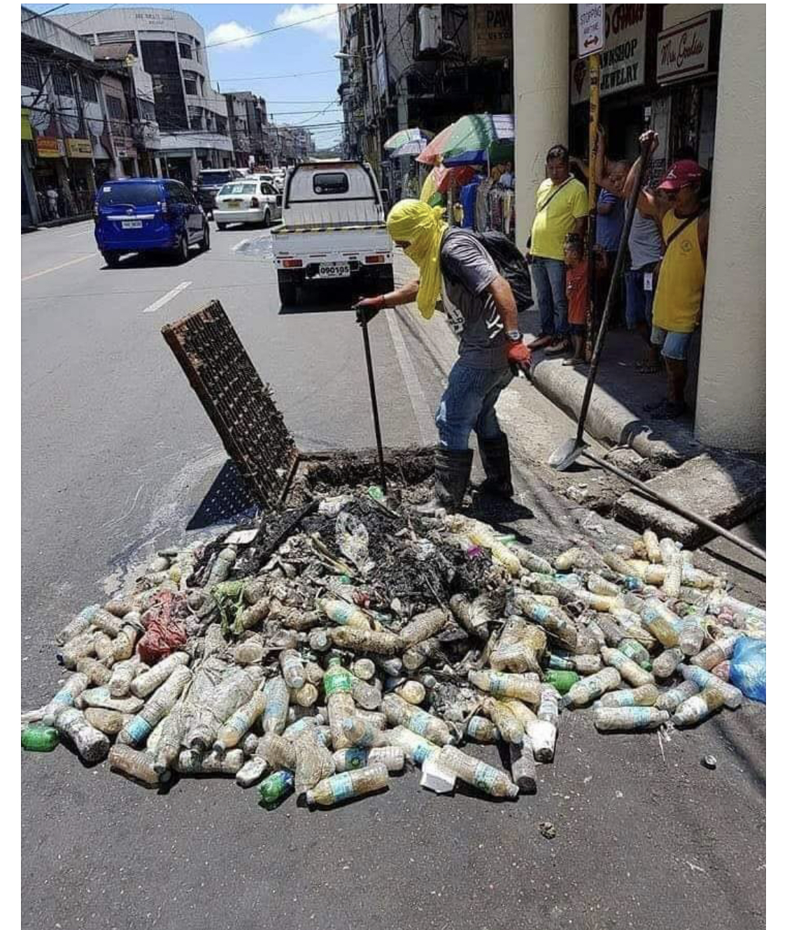 Clogged municipal drain by improperly manages plastic waste